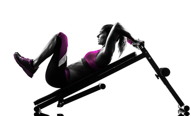 Reverse crunches on an incline bench require focus.