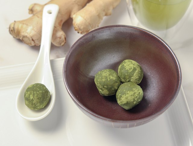 These fat bombs get turned into fancy treats by rolling them into balls and covering them in matcha powder.