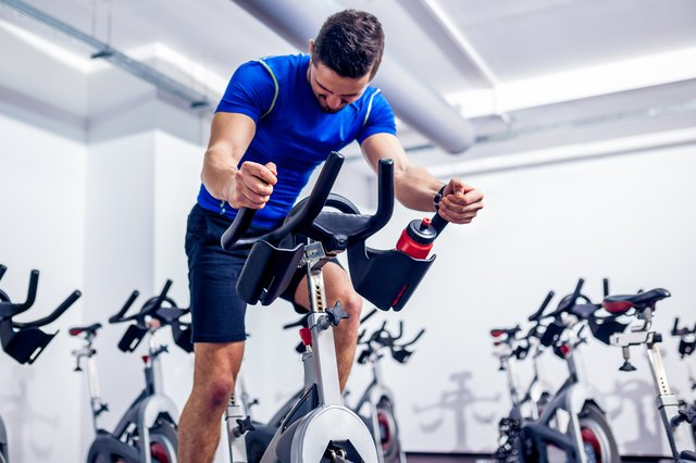 Hop on an exercise bike and pedal away to get your knees warmed up.
