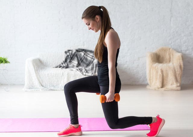 Add weight to your lunges to kick up the intensity a notch.