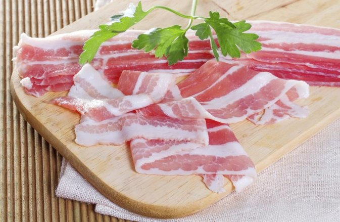 How to Cook Bacon-Wrapped Pork Chops in the Oven
