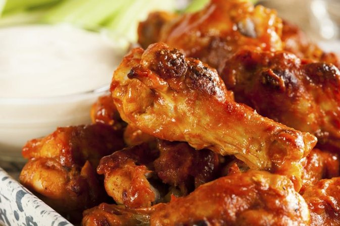 Do You Put Hot Sauce on Wings Before or After You Cook Them?