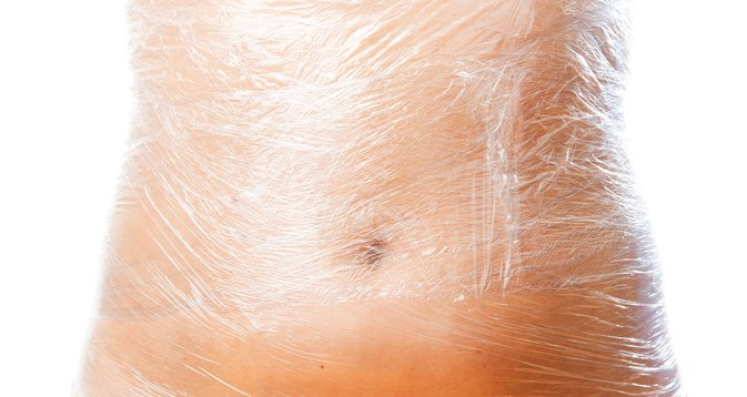 The Dangers of Wrapping Your Stomach With Plastic Wrap