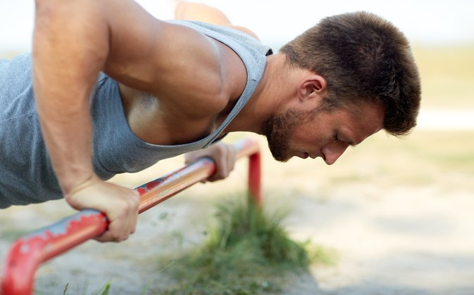 How to Do Push-Ups on an Iron Gym