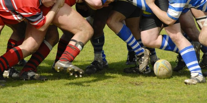 What Is the Difference Between Rugby Cleats & Football Cleats?