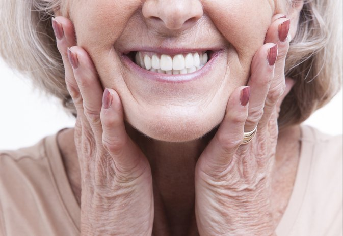 How to Keep My Lower Dentures Secure Without Adhesives