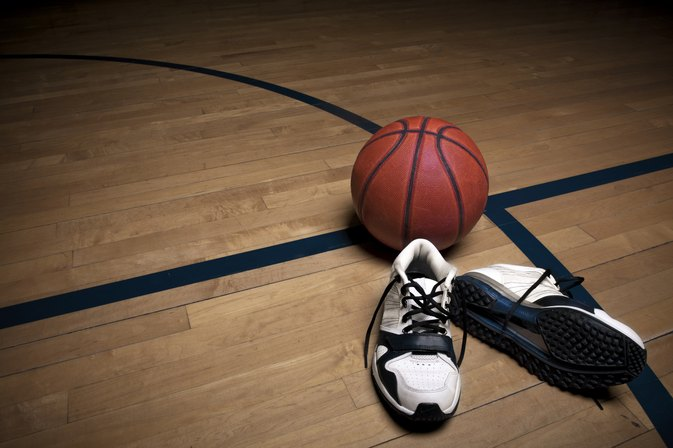 What Is the Difference Between Tennis Shoes & Basketball Shoes?