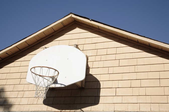 How to attach a basketball backboard to a wall for Basketball garage
