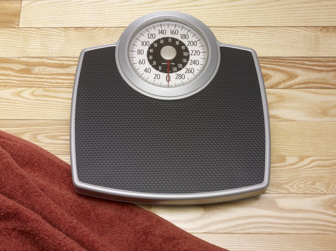 How to Weigh an Obese Person on a Bathroom Scale