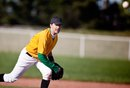 How Should I Field Weak Players in Slow-Pitch Softball?