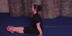How to Sit Up With Your Hands in Gymnastics