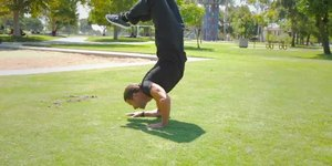 How to Do a Handstand & Touch Your Feet to Yo…