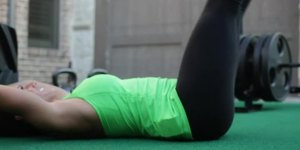 A Thighs-to-Knees Ab Exercise