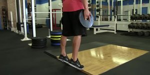 Calf Raises With a Holding Plate