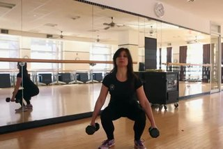 Duck Squat With Dumbbells