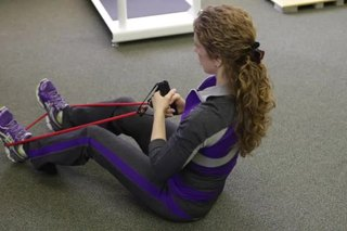 How to Slim Down Your Stomach With Resistance Bands