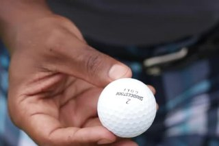 What Do the Letters on a Golf Ball Mean?