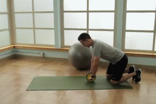 How to Use a Rolling Wheel on Your Knees for Your Abs
