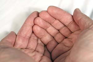 Causes of Hand Tremors & Loss of Grip Strength