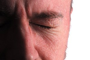 What Are the Causes of Headaches & Sweating?