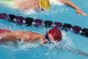 The Effects of Friction on Swimmers