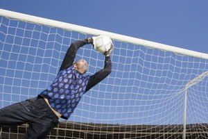 If a Soccer Goalie Has His Hand on the Ball Can a Playe…