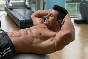 How to Do Sit-Ups With Dumbbells