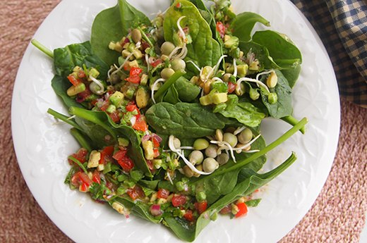 7. Spinach Salad Topped With Avocado and Grapefruit Dressing