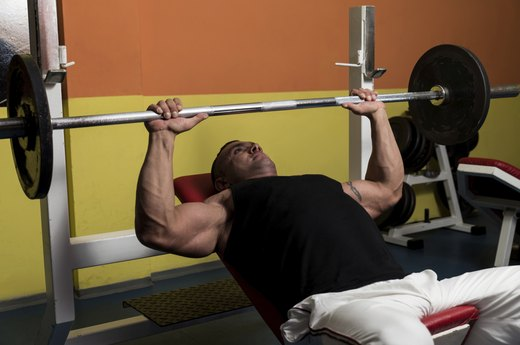7. Machine: Chest Press. Free-Weight Version: One-Arm Dumbbell Chest Press