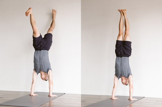 7. Full Handstand at the Wall (Adho Mukha Vrksasana)