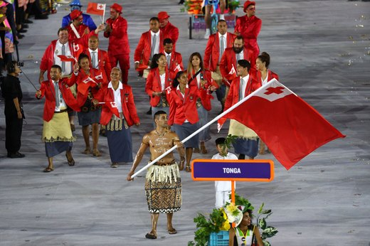 7. Tonga's Oiled Up Flag Bearer