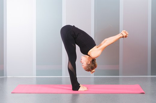 10. Standing Forward Fold With Shoulder Opener (Uttanasana Variation)