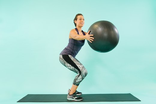 How to Do a Swiss Ball Squat Twist