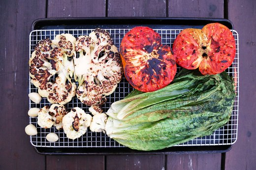 1. Cheesy Cauliflower Steaks With Roasted Lemon Romaine and Tomatoes