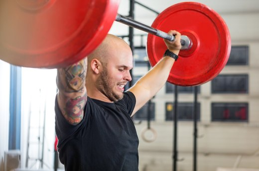 3. Complete a Standing Barbell Press at Your Body Weight