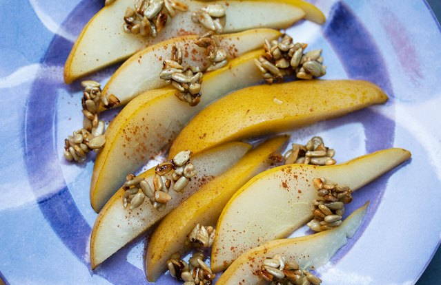 Poached Pears With Candied Sunflower Seeds and Cinnamon