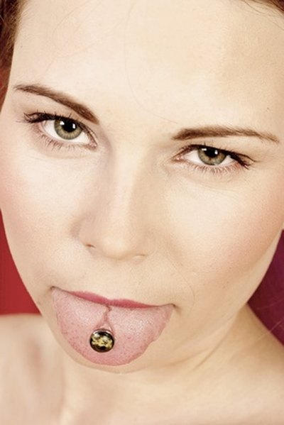 Tongue piercing pain relief livestrong tongue piercing pain relief ccuart Images