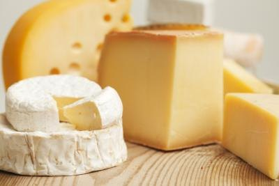 Limit high cholesterol foods, like cheese.