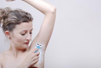 Shave the hair under your armpits, and use a bikini-line trimmer to keep your pubic hair trimmed close.