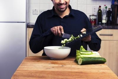 man slicing vegeables