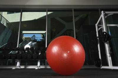 Do your arm exercises while sitting on a stability ball.