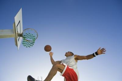 Basketball player in mid air