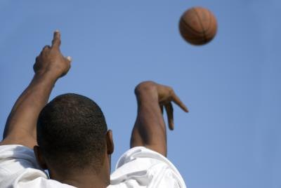 Basketball player shooting ball