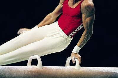 Gymnast on a pommel horse.