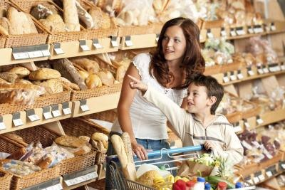 child and mother looking at bread types