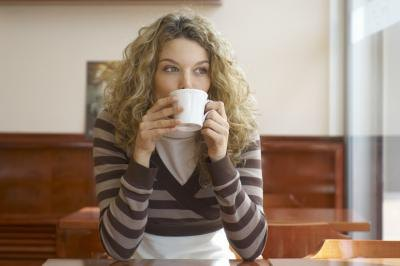 Woman drinking coffee and horizontal