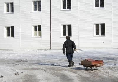 man pulling a sled