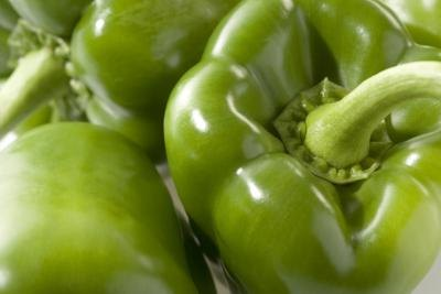 A close up of green peppers.