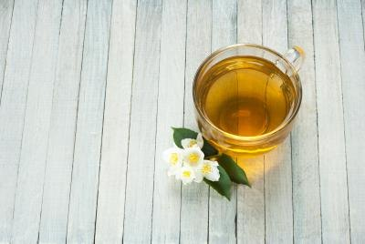Image result for white tea on wooden table