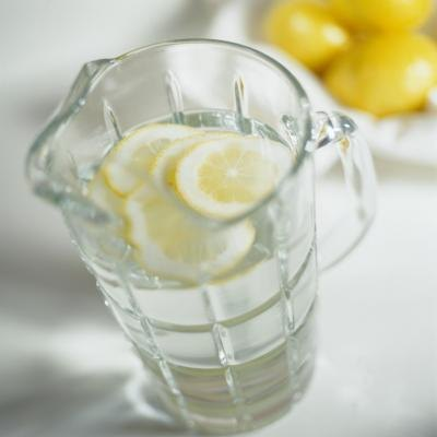 A pitcher of water infused with fresh lemon slices.